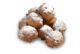 Oliebollen met poedersuiker.zoet .gevuld.gefrituurd.oud en nieuw.jaarwisseling e1481789856503 80x54