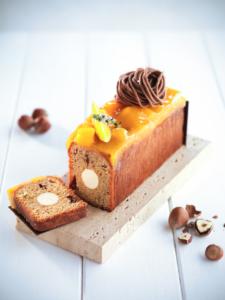 Cake met hazelnoot, mango en yoghurt. Foto: Vandemoortele